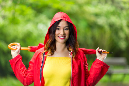 woman in hooded red raincoat